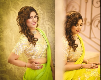 Parrot green sangeet lehenga styled with gold elegant choli and loose curled hairdo