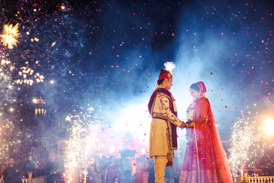 Fireworks, sparkles and rose petal shower- this picture has it all!