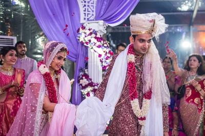 bride and groom taking the saat pheras