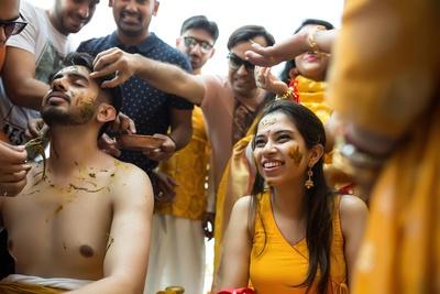 The bride looks so happy at her mehendi ceremony!