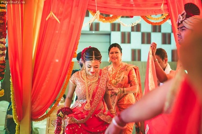 Beautiful bride entering the mandap for wedding rituals held at Clarks exotica resort and spa, bangalore