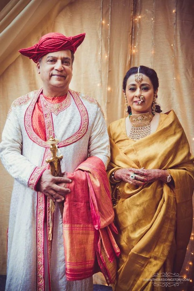 Parents of the bride in their traditional royal attire for the wedding ceremony
