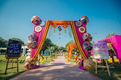 Colorful and quirky decor set up for the mehndi ceremony at  Taj Jai Mahal Palace, Jaipur