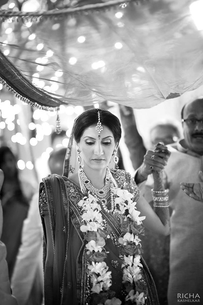 Welcoming the bride in a traditional Indian style at Samode Palce, Jaipur.