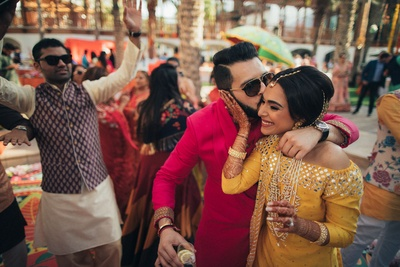 Bride and groom caught in a candid shot for the mehndi ceremony