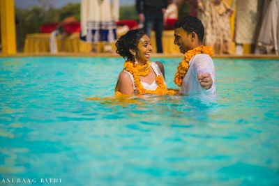 Bride and groom thrown into the pool after their haldi ceremony!