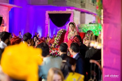 Entering the wedding venue in floral decorated palki for their grand wedding reception at Hotel Fairmont, Jaipur