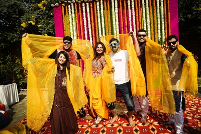 the groom and his squad having fun at the haldi ceremony