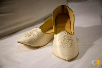 Custom made Mojri matching with the Groom's wedding outfit adorned with a gold kinari