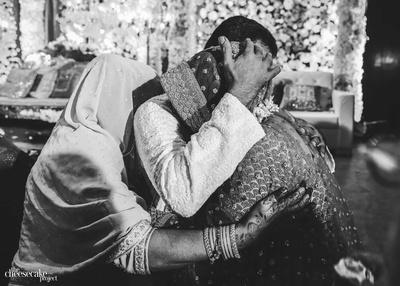 Kainaat hugging her parents goodbye