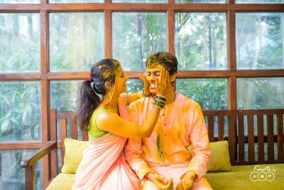 Candid wedding photography of the bride and groom during the haldi function