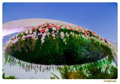 Floral hollow arbor decorated with Lilies, white and pink Carnations, Gladiolus and ferns
