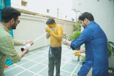 Drenching the groom in champagne