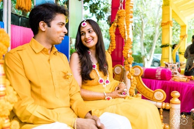 The couple twinning in ochre-yellow outfits is ethereal and beautiful!