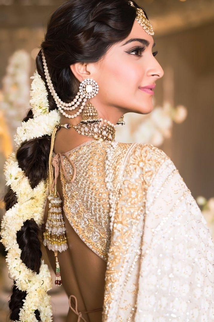 180a1c576dfe3 Sonam Kapoor made a lot of noise with her ivory and gold bridal blouse  design which she wore for her mehendi. This Abu Jani and Sandeep Khosla  lehenga ...