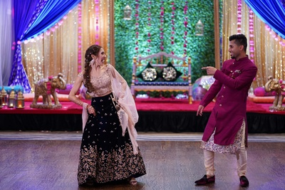 The bride and groom dancing at their sangeet