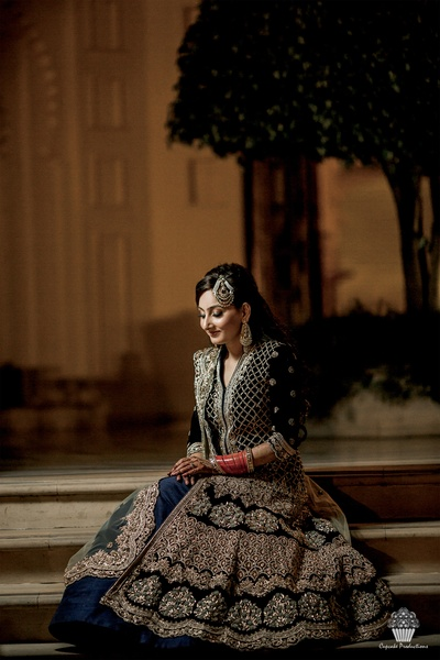 Beautiful bride in a Sabyasachi anarkali suit
