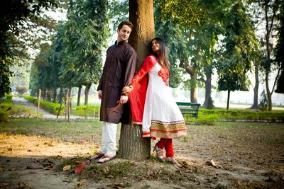 White and red anarkali dress for an outdoor post-wedding shoot