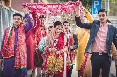 Bridal entry under the fuschia phoolon ki chaddar