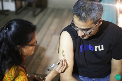 Engraving Tapasi's name on his arms, doing it the conventional way!