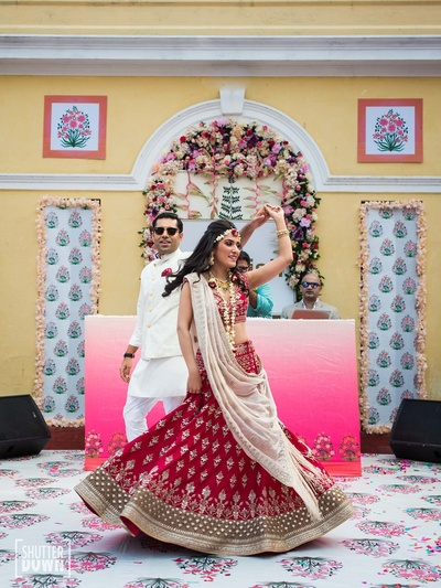 Twirling bride with her groom during the mehndi function