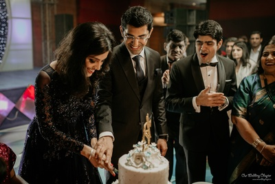 Saakshi and Anant cutting their cake as they begin their wedding ceremonies.