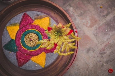 Unique ideas for haldi arrangement by using beautiful earthy plates such as this