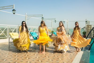 twirling bride with bridesmaids for the haldi photoshoot