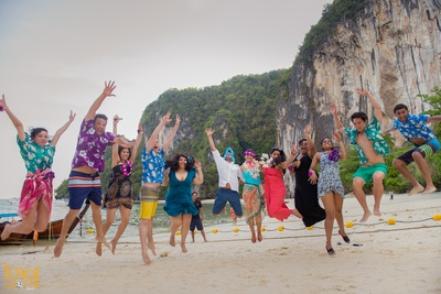 Rushi and Disha's cavalry dressed in vibrant outfits for the privately held beach party in Krabi