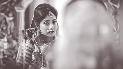 Black and white portrait of the bride getting ready for the wedding function