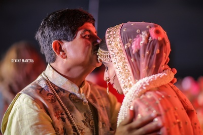 an emotional moment between the bride and her father during the vidaai