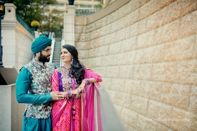 Heena wore a traditional bandhej and leheriya outfit with meenakari earrings and the traditional Rajasthani borla maang tikka while Gurmit went with a blue kurta and a floral Nehru jacket.