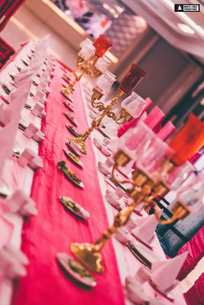 Pink and white furnishings  for a balanced table setting