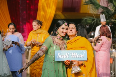 The bride posing with her adorable mum at the mehendi ceremony!