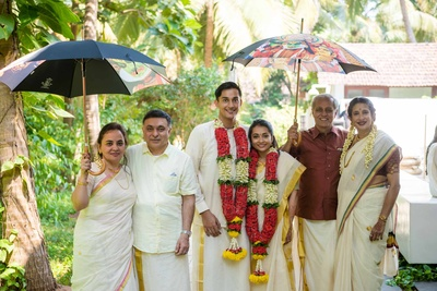 Family photo of the bride and groom with families post wedding function at Aashyana Lakhanpal, Goa