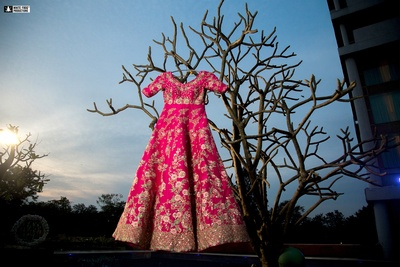 fuschia pink lehenga with detailed work for the bride