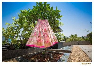 Floral blush pink lehenga embellished with a sheer top lining and a shimmery gold cutwork border