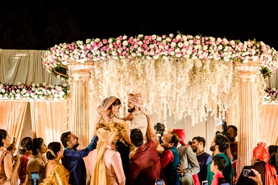 a candid capture of the couple during the jaimala