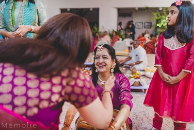 The bride captured in a candid shot at her haldi ceremony