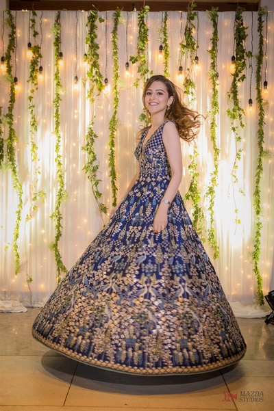 The bride twirling in a ink blue gown with pichwai work by Anita Dongre at her Cocktail held in Mumbai