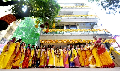 Loved ones of the bride wearing yellow color coordinated traditional Indian wear for the Haldi ceremony