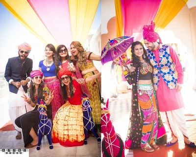 Colourfuly dressed guests enjoying the Rajasthani themed wedding with funny props and super exciting quirky ideas