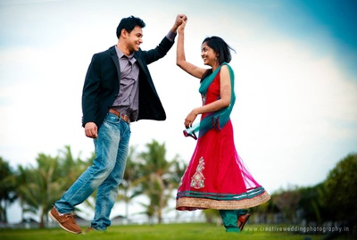 Karthik sporting casual blue denims along with a formal black blazer and grey shirt for the pre-wedding photoshoot
