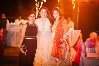 The bride posing with her bridesmaids at her sangeet