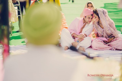 Cute wedding couple shot by Romesh Dhamija Productions.