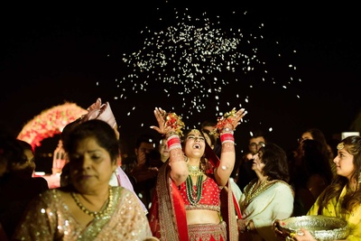 The ever smiling bride throwing rice as a symbol of new life