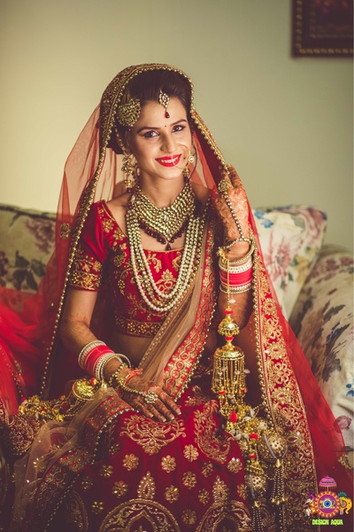 Bridal portraits of Ritika getting ready before the wedding ceremony