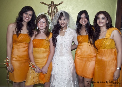 Bridesmaids dress ideas for orange and white themed wedding celebrations