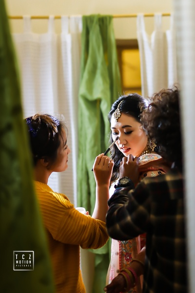 a candid capture of the bride getting ready for her sangeet ceremony