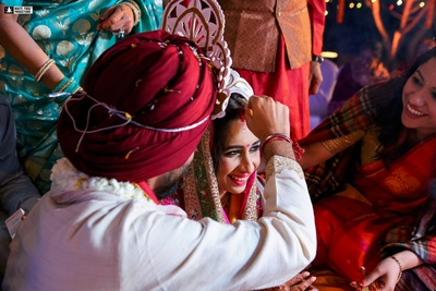 a candid capture of the sindoor ceremony from the Odiya wedding